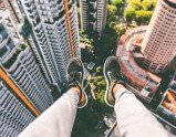 Feet Dangling Over the City